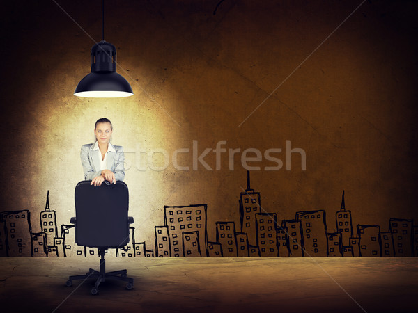 Woman wearing jacket, blouse leaning on chair. Background sketch of buildings Stock photo © cherezoff