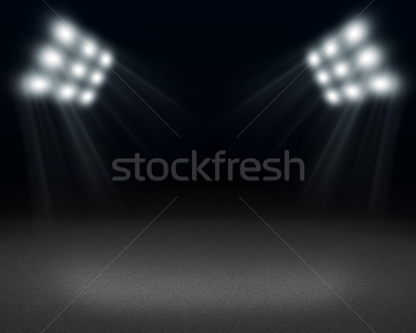 Dark room with spot of light on floor and spotlight at top Stock photo © cherezoff