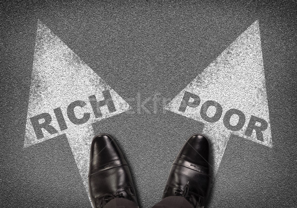 Shoes standing on asphalt with two arrows. Words rich and poor Stock photo © cherezoff