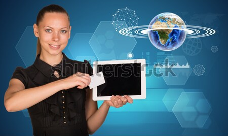 Businesslady holging blank card and tablet Stock photo © cherezoff