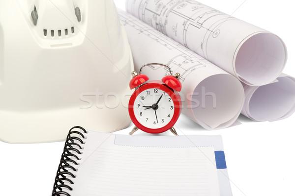 Blueprint rols and helmet with alarm clock Stock photo © cherezoff