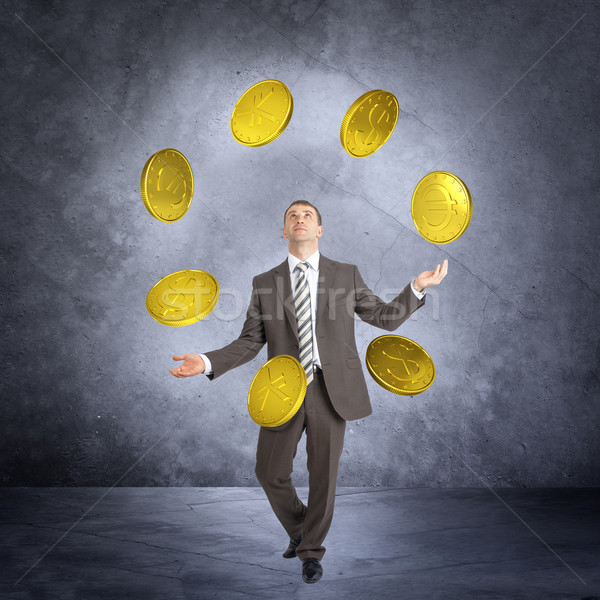 Empresário malabarismo grande moedas abstrato cinza Foto stock © cherezoff