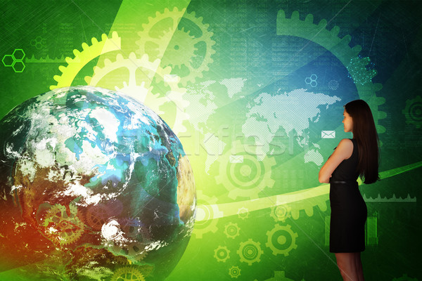 Business woman in front of holographic screen Stock photo © cherezoff