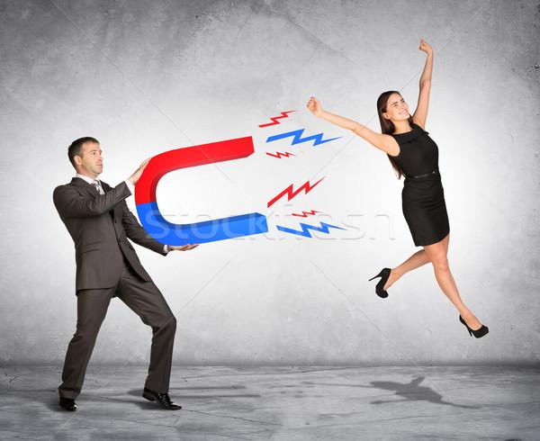 Pessoas marketing empresário mulher ímã homem Foto stock © cherezoff