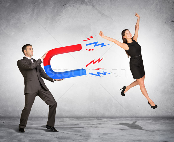 Mensen marketing zakenman vrouw magneet man Stockfoto © cherezoff