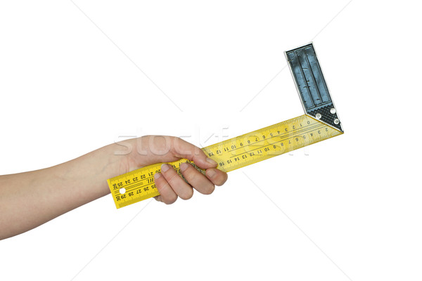 Hand holds the angular ruler Stock photo © cherezoff