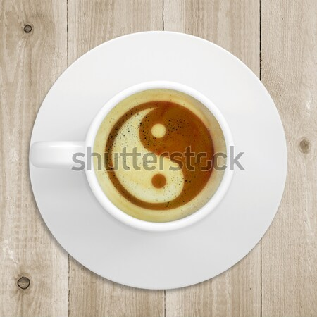 Picture of the yin-yang in the coffee foam Stock photo © cherezoff