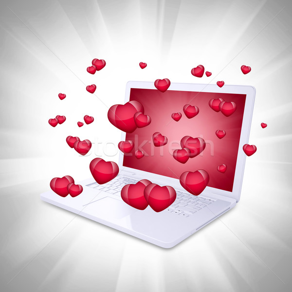 Red hearts fly out of the laptop Stock photo © cherezoff