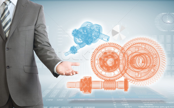 Businessman points hand on wire frame gears Stock photo © cherezoff