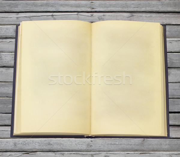 öreg nyitott könyv oldalak szürke fából készült textúra Stock fotó © cherezoff