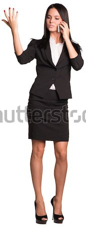 Women talking on phone and raised hand up Stock photo © cherezoff