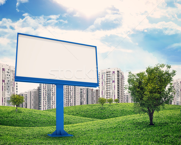 high-rise buildings over green hills and billboard Stock photo © cherezoff