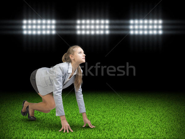 Businesswoman standing in running start pose  Stock photo © cherezoff