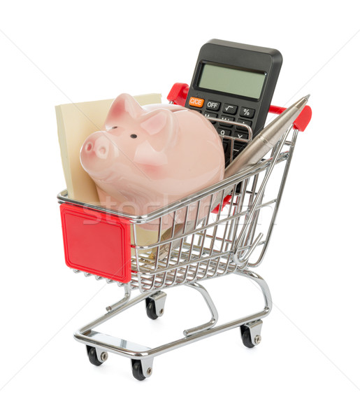 Alcancía dotación cesta de la compra calculadora aislado blanco Foto stock © cherezoff