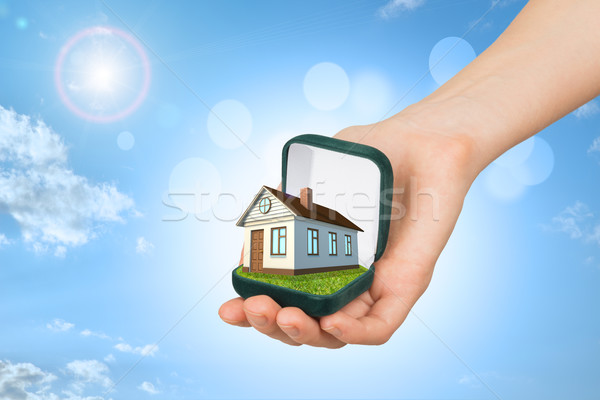 Empty ring box with brown house in humans hand Stock photo © cherezoff