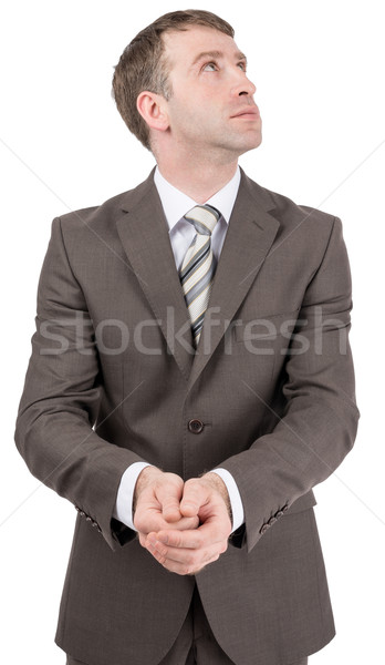 Businessman holding hands in front of him Stock photo © cherezoff