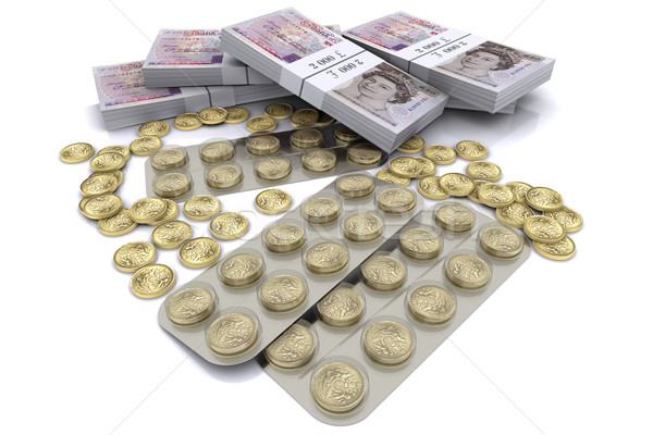 pack of tablets with the coins Stock photo © cherezoff
