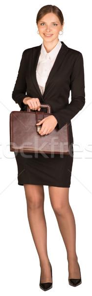 Imprenditrice stand valigetta mano isolato Foto d'archivio © cherezoff