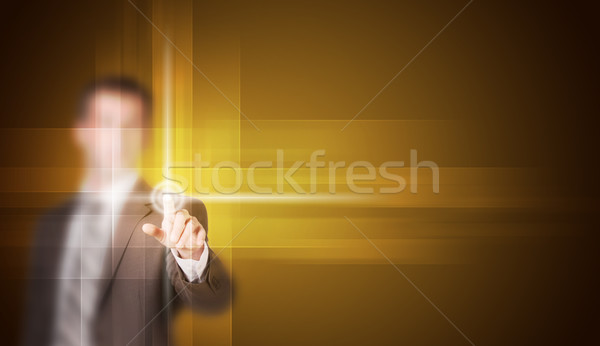 Businessman in suit finger presses virtual button Stock photo © cherezoff