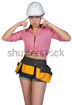 Stock photo: Pretty girl in shorts, shirt and white helmet standing with hands on hips