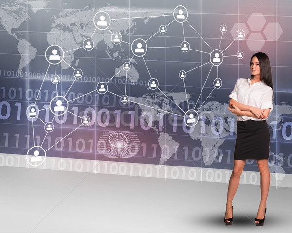 Businesslady with crossed arms Stock photo © cherezoff