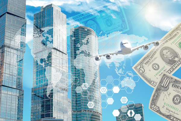 Business building with world map and money Stock photo © cherezoff