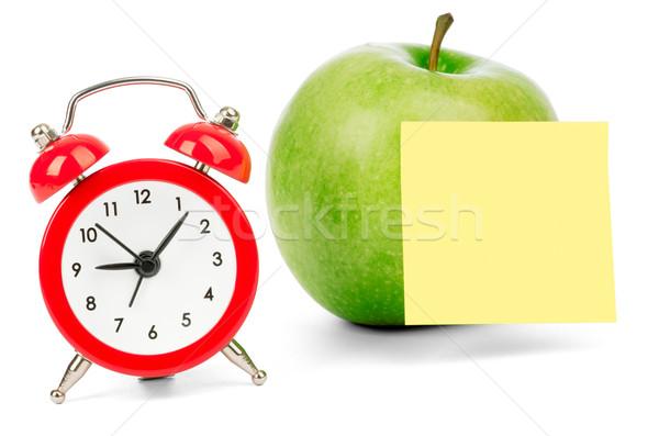 Fresco maçã despertador adesivo isolado branco Foto stock © cherezoff
