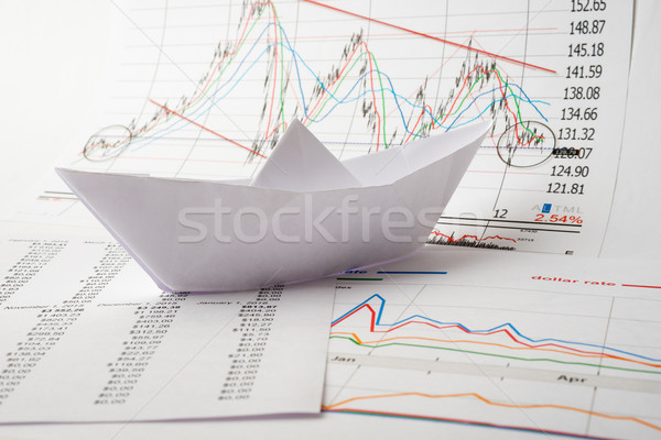 Paper boat floats on documents Stock photo © cherezoff
