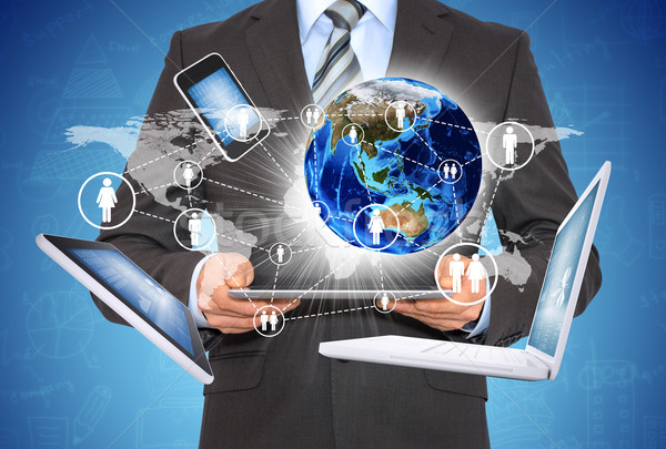 Man holding tablet. Near the earth and electronics Stock photo © cherezoff