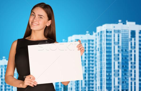 Businesswoman with new houses Stock photo © cherezoff