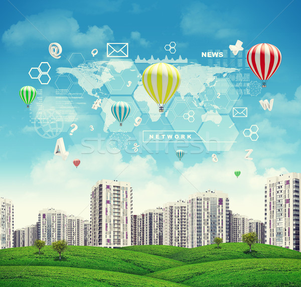 High-rise buildings over green hills, few air baloons above. Charts, diagrams and other virtual item Stock photo © cherezoff