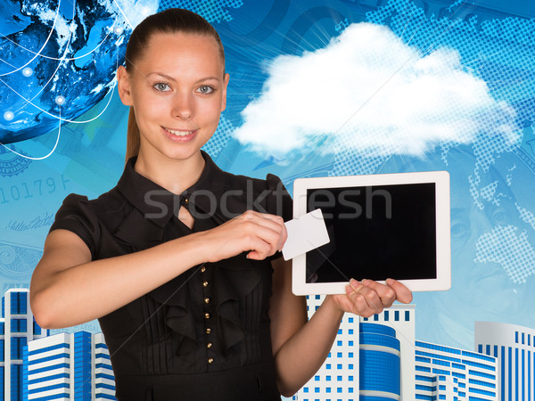 Beautiful businesswoman holding tablet PC. Globe, world map and other virtual elements as backdrop Stock photo © cherezoff