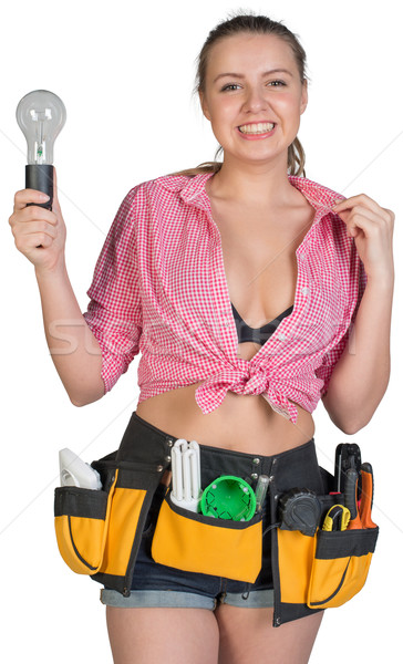 Woman in tool belt holding lamp bulb Stock photo © cherezoff