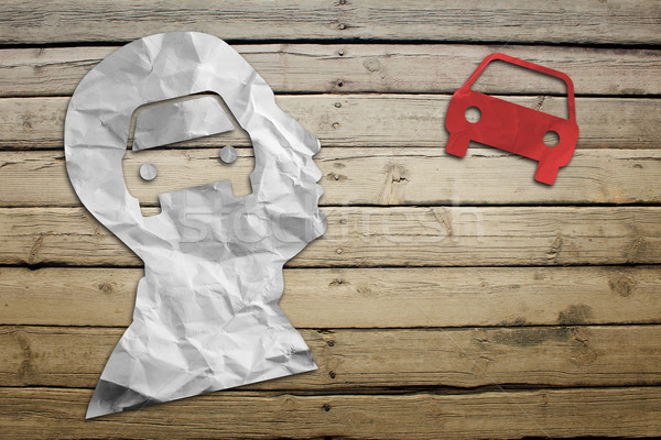 Paper humans head with car symbol Stock photo © cherezoff