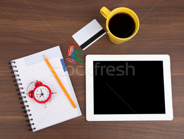 Blank copybook with tablet and alarm clock Stock photo © cherezoff