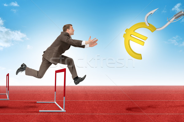 Man hopping over treadmill barrier with euro sign Stock photo © cherezoff