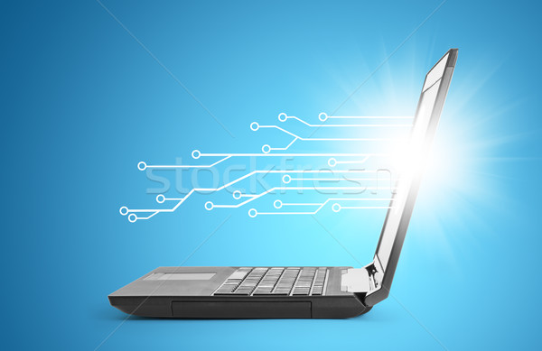 Laptop with lightspot Stock photo © cherezoff