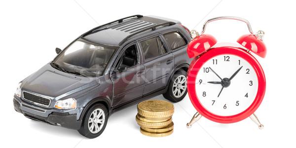 Carro moedas despertador alarme dinheiro relógio Foto stock © cherezoff