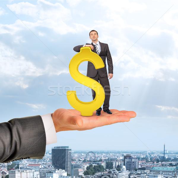 Empresário cifrão grande mão cidade fundo Foto stock © cherezoff