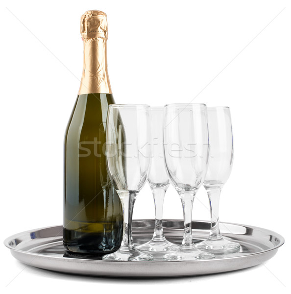 Champagne bottle and four glasses Stock photo © cherezoff