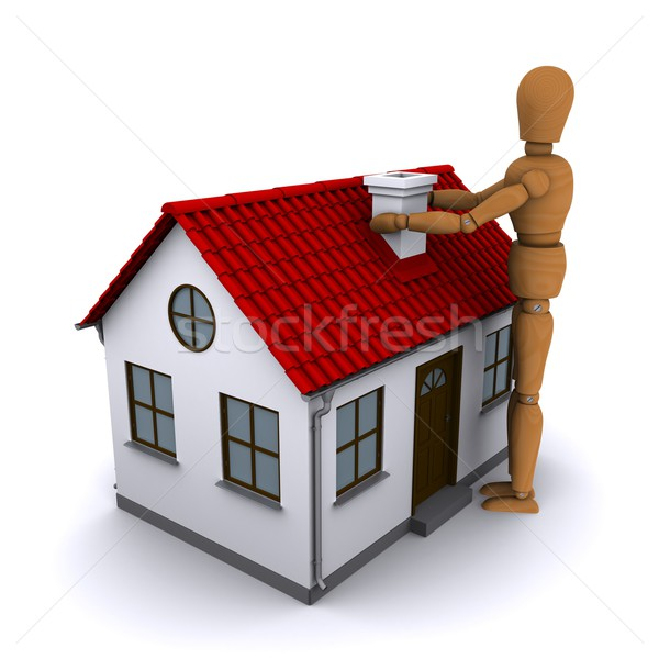 The wooden man holding both hands over the chimney house with red roof. 3D rendering Stock photo © cherezoff