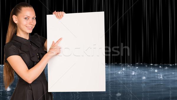 Businesswoman holding empty paper Stock photo © cherezoff
