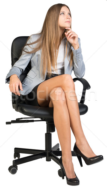 Businesswoman on office chair with her finger under chin, looking upwards Stock photo © cherezoff