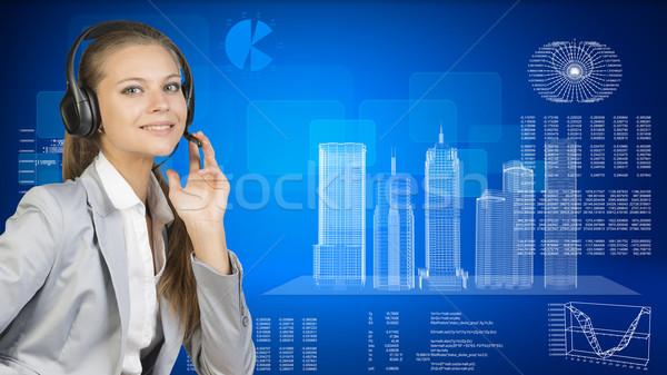üzletasszony headset felhőkarcolók vmi mellett grafikonok különböző Stock fotó © cherezoff