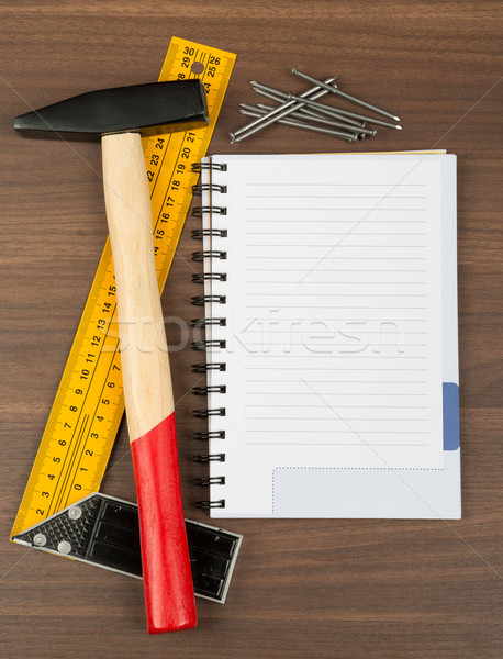 Hammer with note pad and nails Stock photo © cherezoff