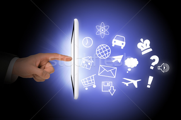 Tablet with icons and humans hand Stock photo © cherezoff