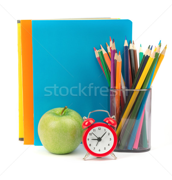 Copybooks with green apple and alarm clock Stock photo © cherezoff