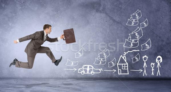 Businessman running forward Stock photo © cherezoff