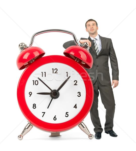 Businessman with big alarm clock Stock photo © cherezoff