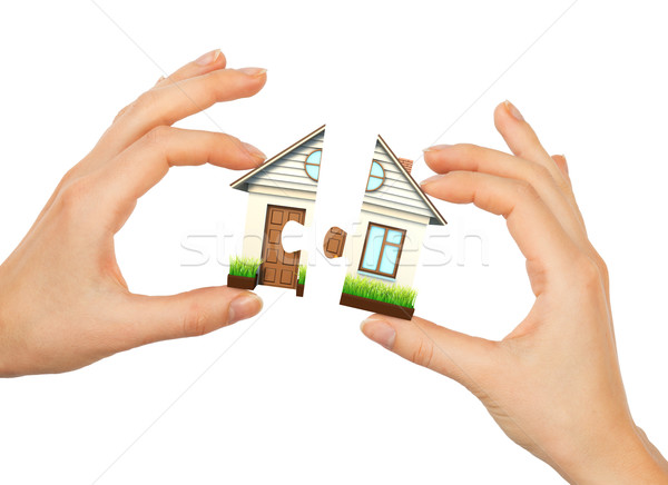 Womans hand making house puzzle Stock photo © cherezoff